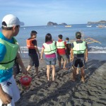 People getting to the bangka; islands on the horizon